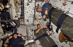 sleeping astronauts demonstrate the neutral position for arms and shoulders