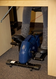 The j/fit Under Desk Elliptical weighs in at 26.5 pounds and a little over 27 inches long.