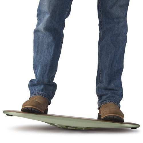 Man standing on FluidStance The Original, balance board for standing desk