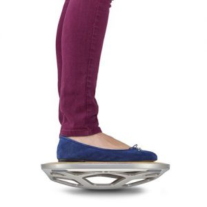 Woman stands on Fluidstance Level balance board