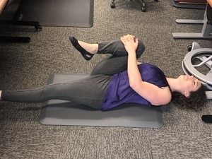 Standing Desk Stretches - Double Knee to Chest 1